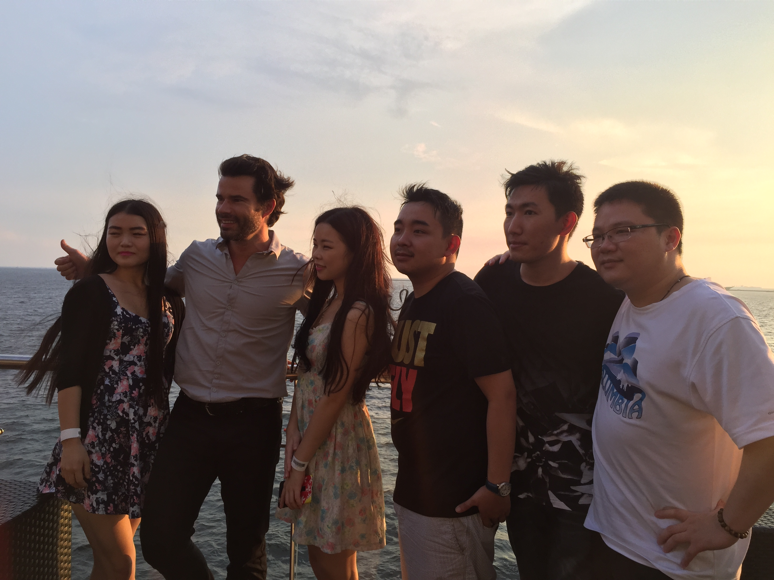 Antonio with his new friends in Manila at White Moon Bar, Manila Bay.